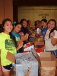 From Stuff the Bus to stuff the bags In preparation for 2014 Health Fair